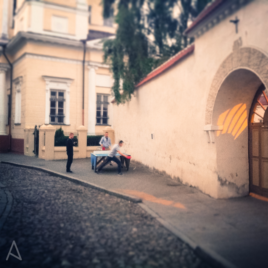 Picture I took on a Sunday night at around 10:30PM. It's still light outside and some guys are playing ping pong in the middle of the street in Old Town.
