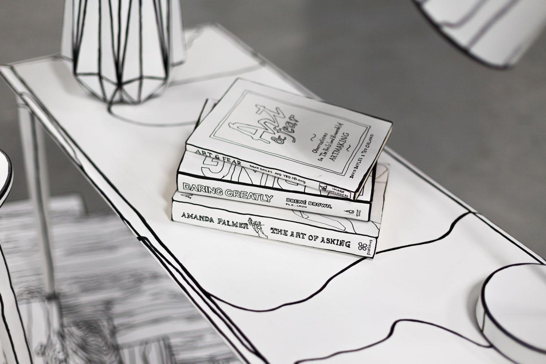 line drawing of three books