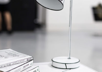 line drawing of a desk lamp and books