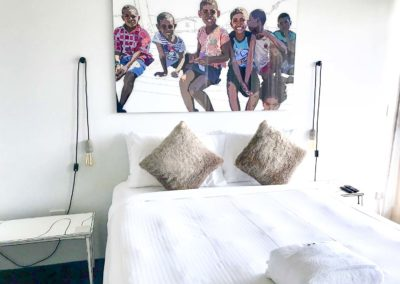 large artwork over a bed