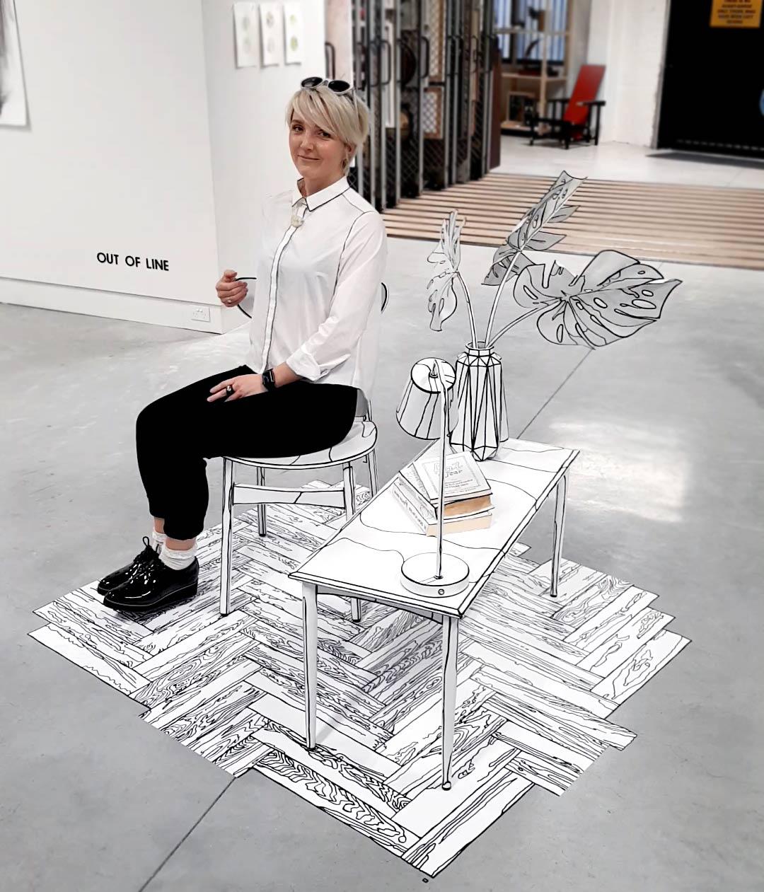 Anastasia Parmson sitting in her drawing installation